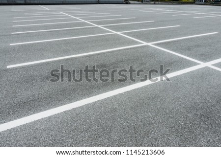 Empty parking lot, Vacant Parking Lot, Parking lane painting on floor, copy space #1145213606