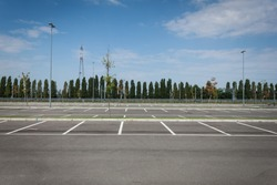 Empty parking lot with trees in the distance