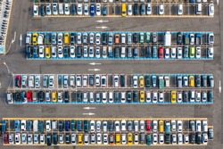 Empty parking lots, aerial view. A lot of cars in the parking lot. Colorful moody drone shoot.