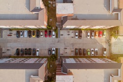Empty parking lots in front of buildings, aerial view.
