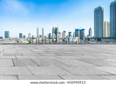 empty pavement and modern buildings in city #450990913