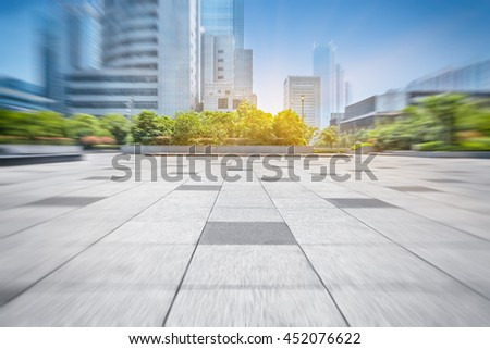 empty pavement and modern buildings in city #452076622