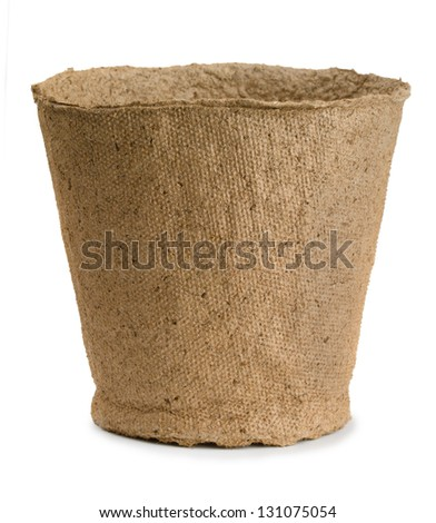 Empty peat pot isolated on white