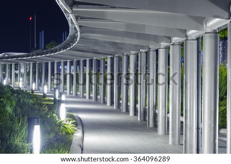 Empty pedestrian walkway in the park at night