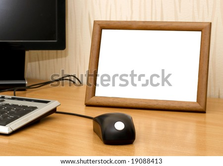 Empty photo frame on computer table