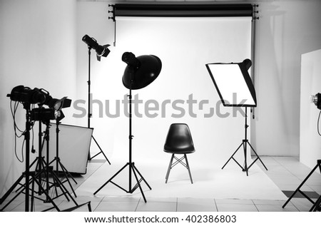 Empty photo studio with lighting equipment #402386803