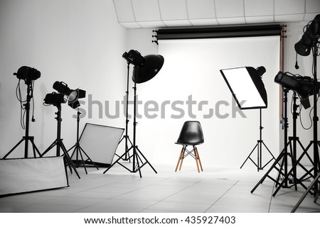 Empty photo studio with lighting equipment #435927403