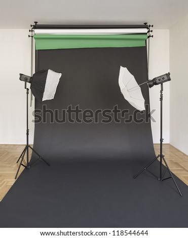 Empty Photo Studio with Lights and Black Backdrop