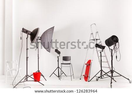 Empty photographic studio with modern lighting equipment