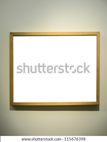 Empty picture frame on gallery wall