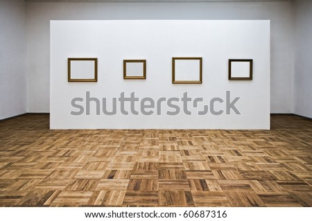 Empty picture frames in the art gallery room