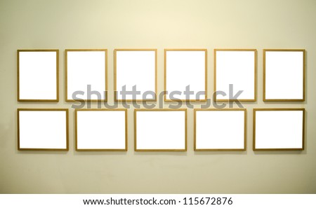 Empty picture frames on gallery wall