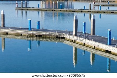 Empty pier in winter during windless weather