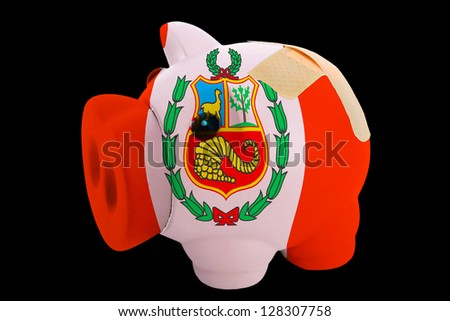 empty piggy rich bank in colors of national flag of peru on black background