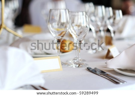 Empty place card on a white festive table