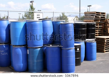 empty plastic drums for chemicals at a recycling location