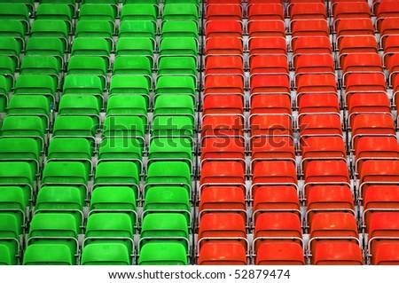 Empty plastic seats at stadium, outdoor sports arena.