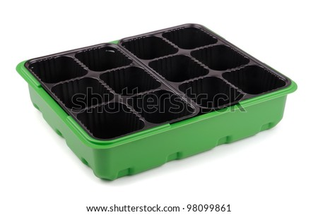 Empty plastic seedling tray isolated on white