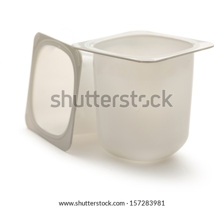 Empty plastic yogurt pots on white
