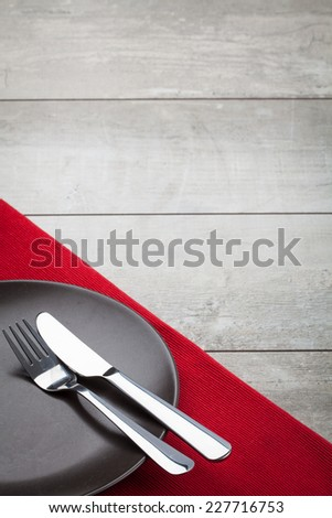 Empty Plate, Fork, Knife on wooden background. Top View with Text Space