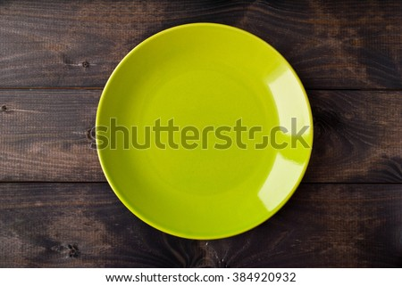 Empty plate on rustic wooden background. Top view