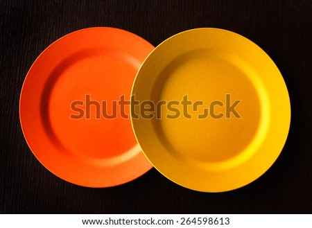 Empty Plate - Orange and yellow around empty plate on wooden background.