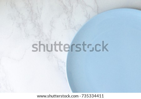 Shutterstock empty plate top view marble copy space.