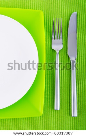 Empty plate with utensils