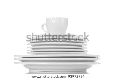 empty plates and cup isolated on white - stock photo
