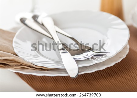Empty plates and cutlery #264739700