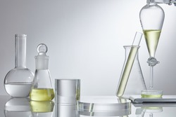 Empty platform for cosmetic bottle containers and scientific glassware. Herbal medicine natural organic and scientific glassware. Research and development concept.