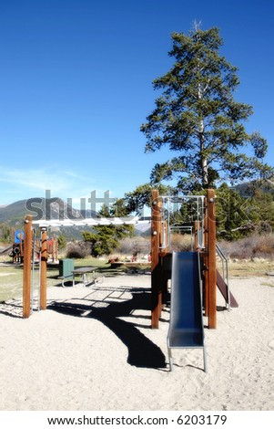 Empty playground in the Colorado mountains - can also represent lack of exercise/activity by today's children.