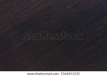 Empty plowed field in late autumn, aerial top down view. Dark earth and farmland agriculture background #1566651235