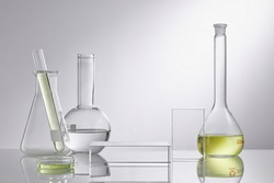 Empty podium glass for cosmetic bottle containers. Research and develop beauty skincare product concept with scientific glassware. Concept laboratory tests and research natural extract making cosmetic