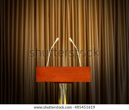 empty podium with microphones over curtains in background #485451619