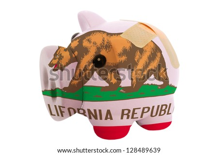 empty poor man piggy rich bank in colors flag of us state of california on white