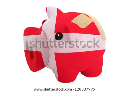 empty poor man piggy rich bank in colors national flag of denmark on white