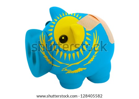 empty poor man piggy rich bank in colors national flag of kazakhstan on white