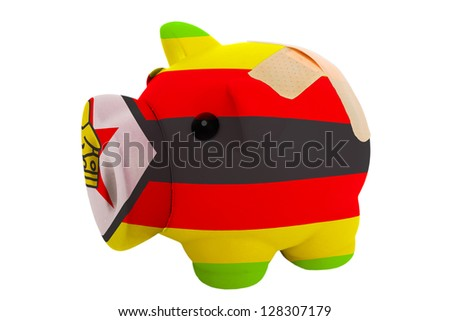 empty poor man piggy rich bank in colors national flag of zimbabwe on white