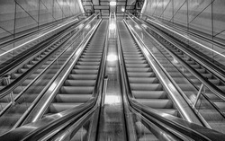 Empty Public Escalator of a metro staion in Black and White, The Netherlands