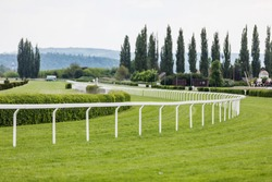 Empty racing track. Treated green grass ready for horse racing in spring day.
