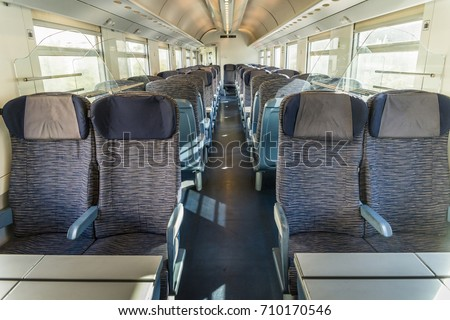 Empty rail passenger carriage seat rows with dimishing perspective - Shutterstock ID 710170546