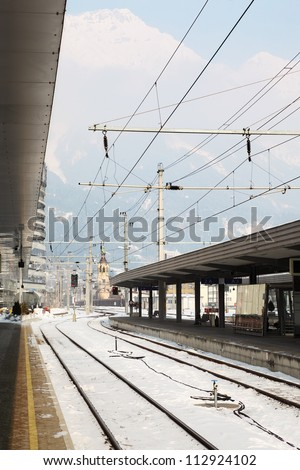 Empty Railway station at winter day at background of mountains.