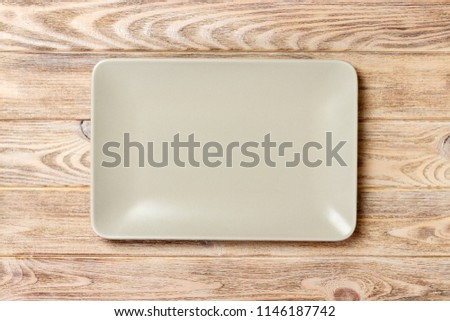 empty rectangular Plate on wooden table background.