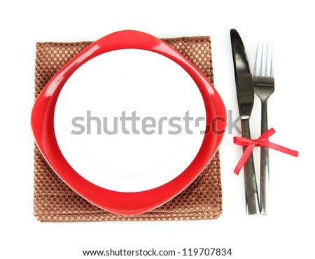 Empty red and white plates with fork and knife isolated on white