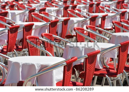 Empty red chairs and tables