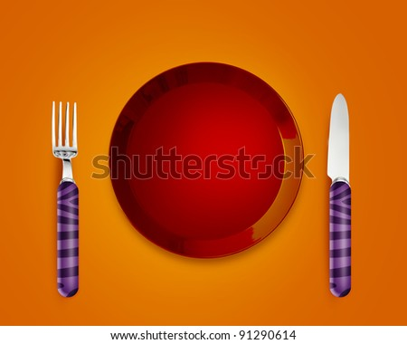 Empty red Plate with knife and fork.