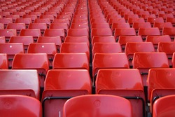 Empty red seats in a row at the sport stadium
