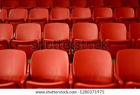 Empty red seats in stadium #1280371975