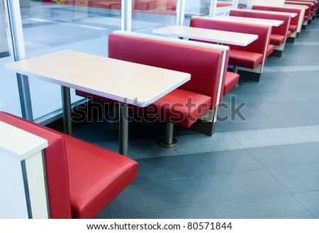 Empty restaurant interior with stage waiting for customers.